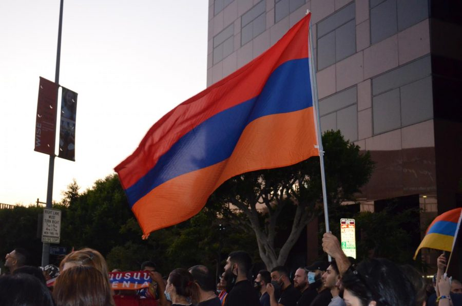 A protester holds an Armenian flag among the crowd of protesters outside the Azerbaijan Consulate in Brentwood on Wednesday, Sept. 30, 2020.