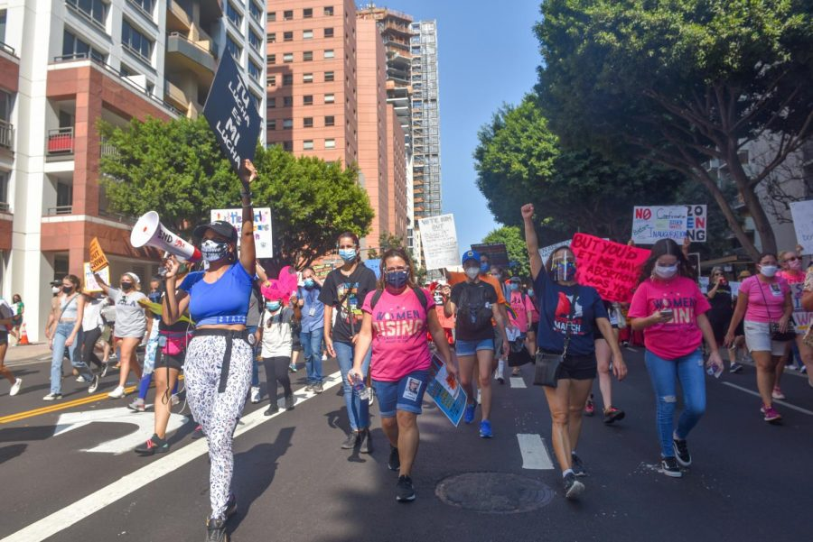 Protesters making their way through downtown Los Angeles for the Women's March on Saturday, Oct. 17, 2020. The march in L.A. was one of over 400 in-person and virtual marches organized nationwide.