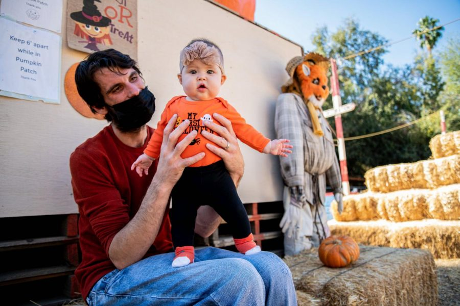 Tyler Beasley and his daughter, Lily Beasley, enjoy some quality time at Tapia Brothers Farm in Encino, Calif., on Thursday, Oct. 29, 2020.