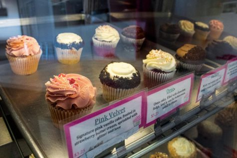 Customers' favorite cupcakes are displayed behind food labels that describe their flavors and ingredients at A Sweet Design bakery in Granada Hills, Calif., on Friday, Sept. 25, 2020.