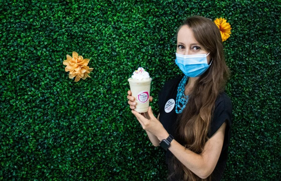 Rachel Howry, the owner of Forever Healthy, poses with the top-selling drink Birthday Cake protein smoothie in Chatsworth, Calif,. on Thursday, Oct. 1, 2020.