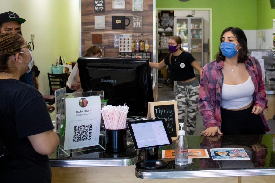 Mandi Macias, a Forever Healthy nutrition confectioner, interacts with customers at Forever Healthy in Chatsworth, Calif,. on Thursday, Oct. 1st, 2020.