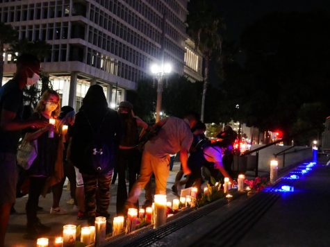 Mourners placing candles on the steps of Los Angeles City Hall in remembrance of George Floyd on his 47th birthday on Wednesday, Oct. 14, 2020.