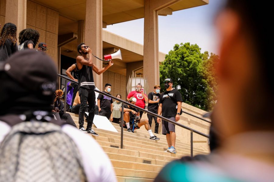 A protester speaks to the crowd of protesters in front of the Oviatt Library during the Northridge Black Lives Matter protest on June 2, 2020.