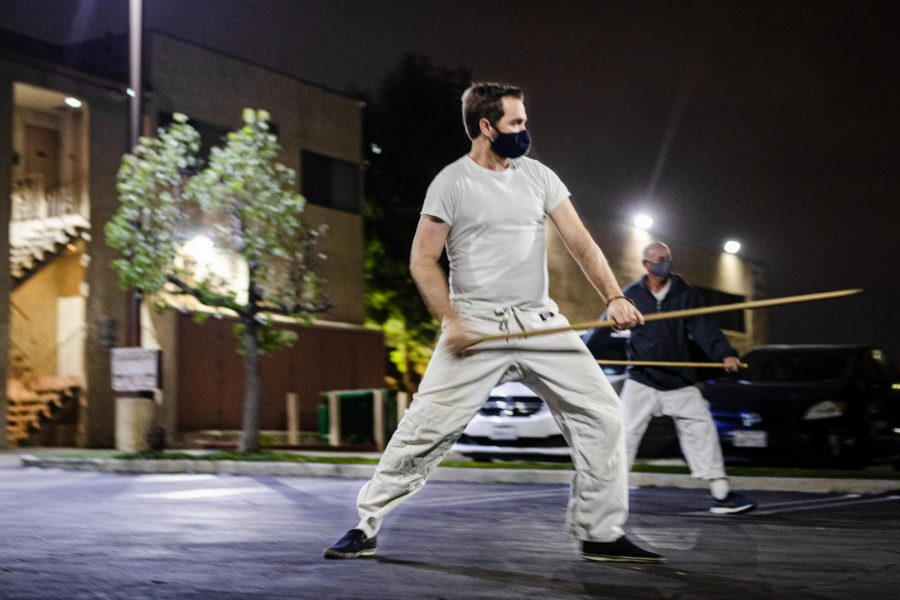 David Goldberg practices with a Jo, a staff, in the parking lot behind North Valley Aikikai in Northridge, Calif., on Friday, Nov. 6, 2020. Jo staffs are used in every class for social distancing, according to Lee Lavi.