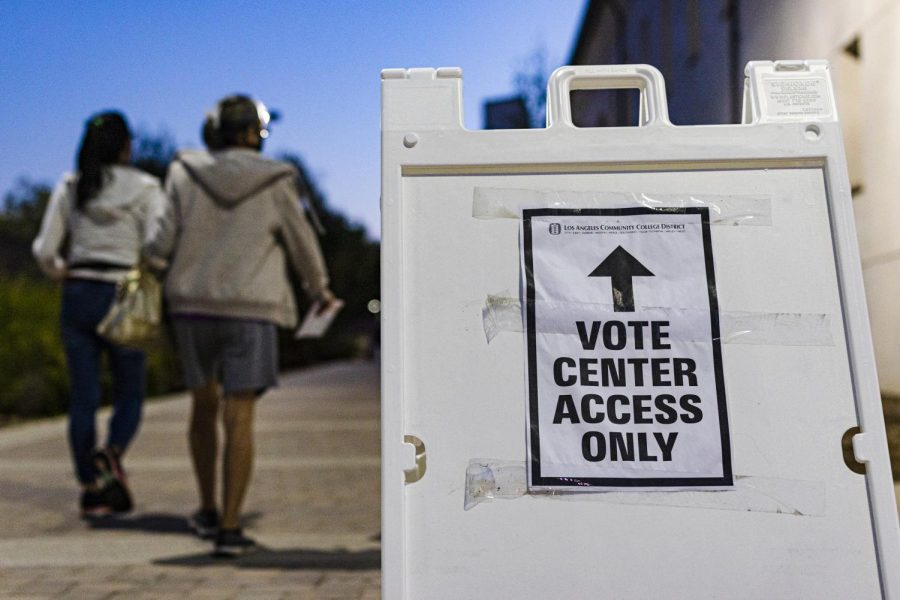 Voters walk toward the vote center at Los Angeles Pierce College in Woodland Hills, Calif., on Tuesday, Nov 3, 2020.
