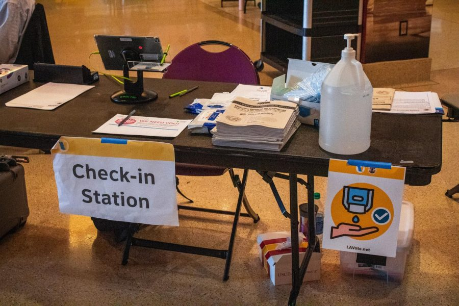 The voter check-in station at the Galen Center at USC in Los Angeles, Calif., on Tuesday, Nov. 3, 2020.