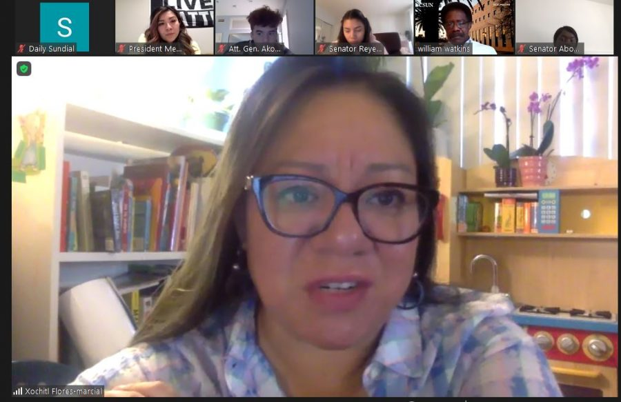 Assistant Professor Xóchitl Flores-Marcial discusses Delmar T. Oviatt's legacy during Monday's AS meeting.