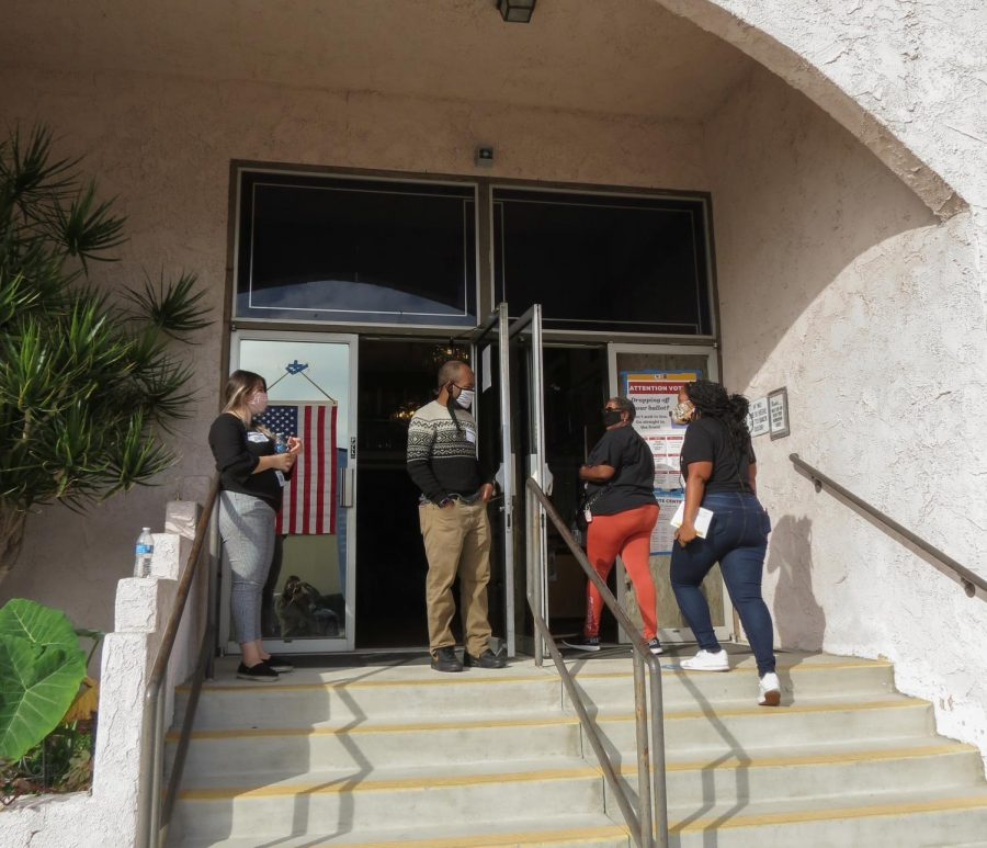 Poll workers welcoming voters at the voting center in Elk Lodge on Election Day on Nov. 3, 2020 in Canoga Park, Calif.