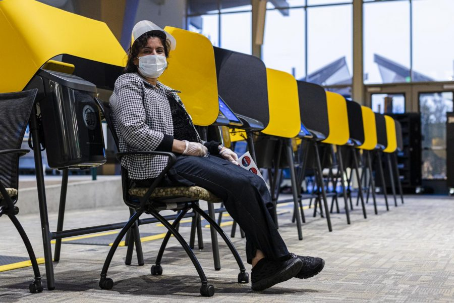 Farah Seyfi, a medical worker, volunteers at the vote center at Los Angeles Pierce College in Woodland Hills, Calif., on Tuesday, Nov. 3, 2020.