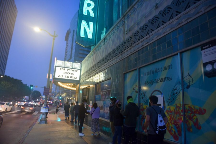 Voters stand in line at the Wiltern Theatre in Los Angeles on Tues. Nov. 3, 2020.