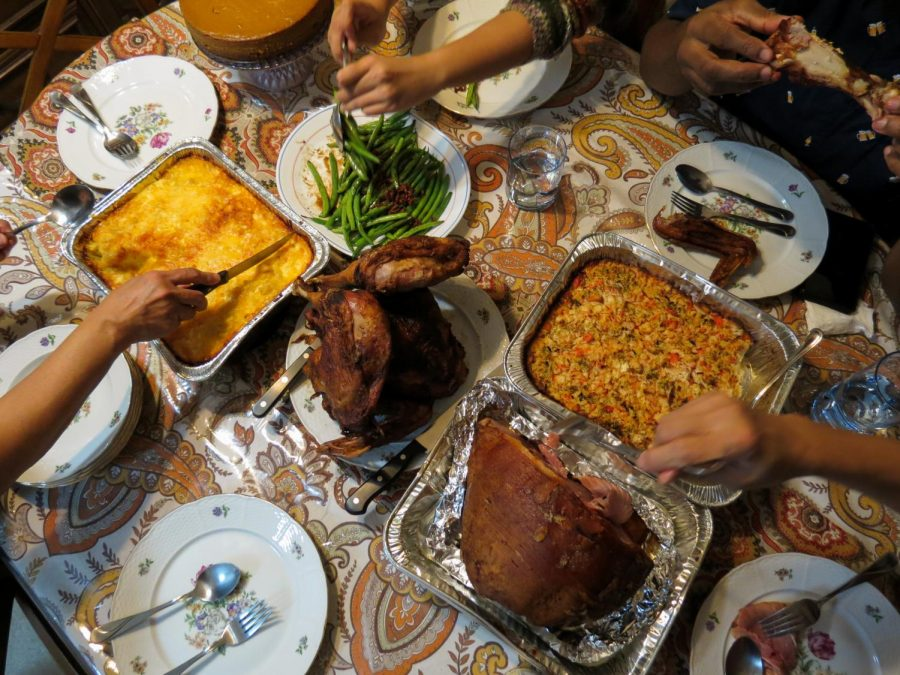 Mac & cheese, green beans, fried turkey,  baked ham, and a sushi bake spread across the Cortezes' Thanksgiving dinner table.