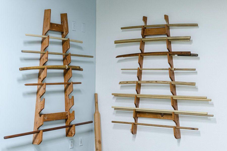 Bokkens, Japanese wooden swords, on the racks at North Valley Aikikai in Northridge, Calif., on Friday, Nov. 6, 2020.