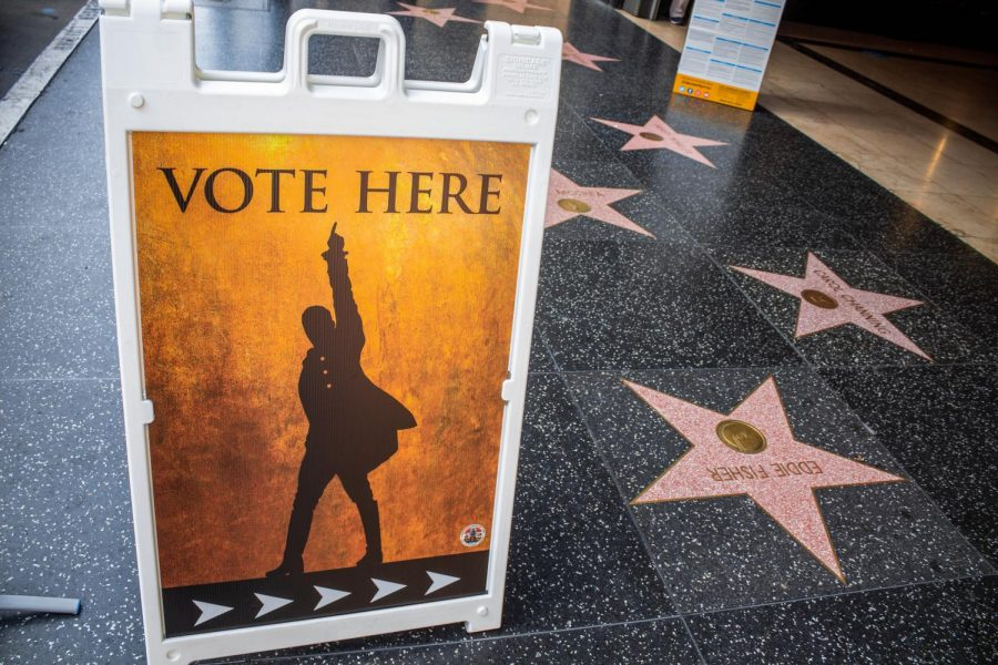 A Hamilton-themed poster directing voters to the voting center outside of the Pantages Theater in Hollywood, Calif., on Tuesday, Nov. 3, 2020.