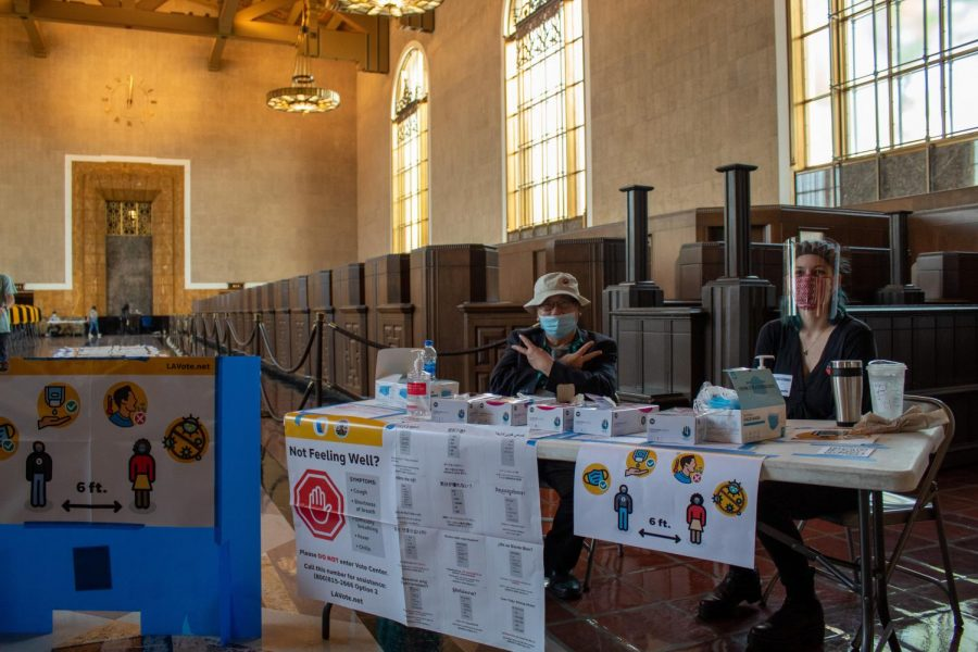 Los Angeles County poll workers at the check-in table at the Union Station voting center in Los Angeles, Calif., on Tuesday, Nov. 3, 2020.