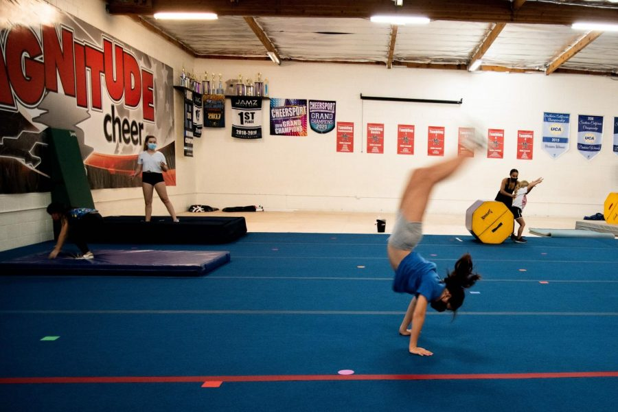 Natalie Nakata does a flip at Magnitude Cheer in Northridge, Calif., on Wednesday, Nov. 4, 2020.