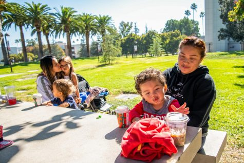 Kenia Ochoa, left, and her children, Bell and Sonny Brooks, spend time with Andrea Antonio, right, and her son, Luca DeLeon, at the CSUN campus on Nov. 13, 2020.