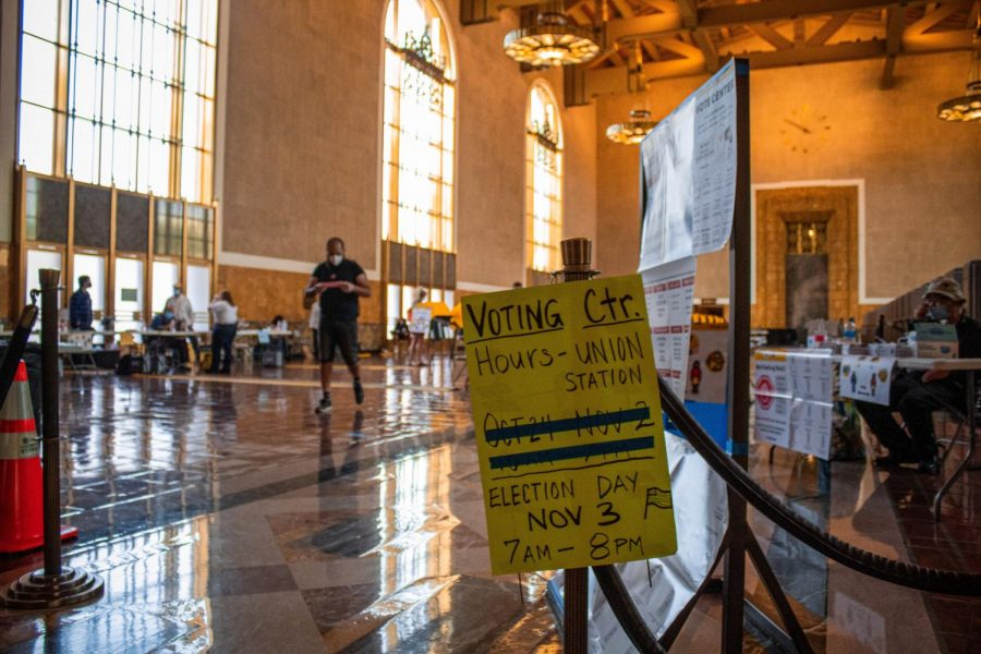 A sign displaying the Union Station voting center's operating hours in Los Angeles, Calif., on Tuesday, Nov. 3, 2020.