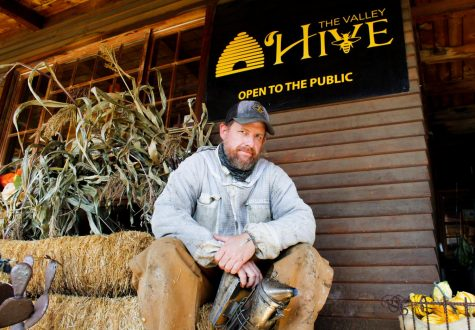 Keith Roberts, the co-owner and lead beekeeper at The Valley Hive sits outside of the gift shop on Nov. 5, 2020, in Chatsworth, Calif.