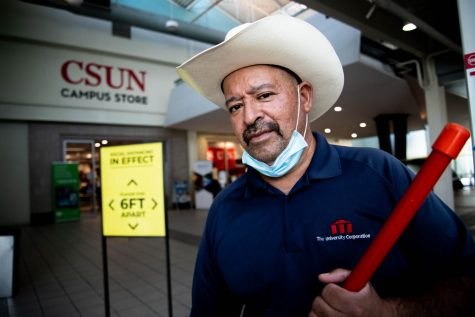 David Ramos, a CSUN custodian, prepares to mop outside of the CSUN Campus Store on Nov. 17, 2020. Ramos , who has been employed as a custodian at CSUN for 23 years, said he loves CSUN and he misses the campus community.