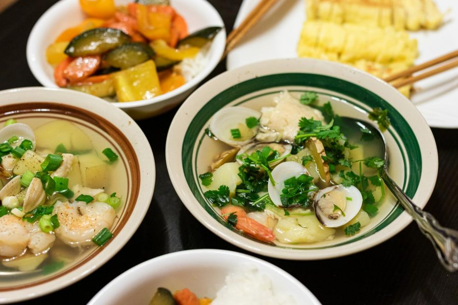 Seafood soup, vegetable chowder, rice, and tamagoyaki are served on Christmas Eve in Los Angeles, Calif., on Thursday, Dec. 24, 2020.