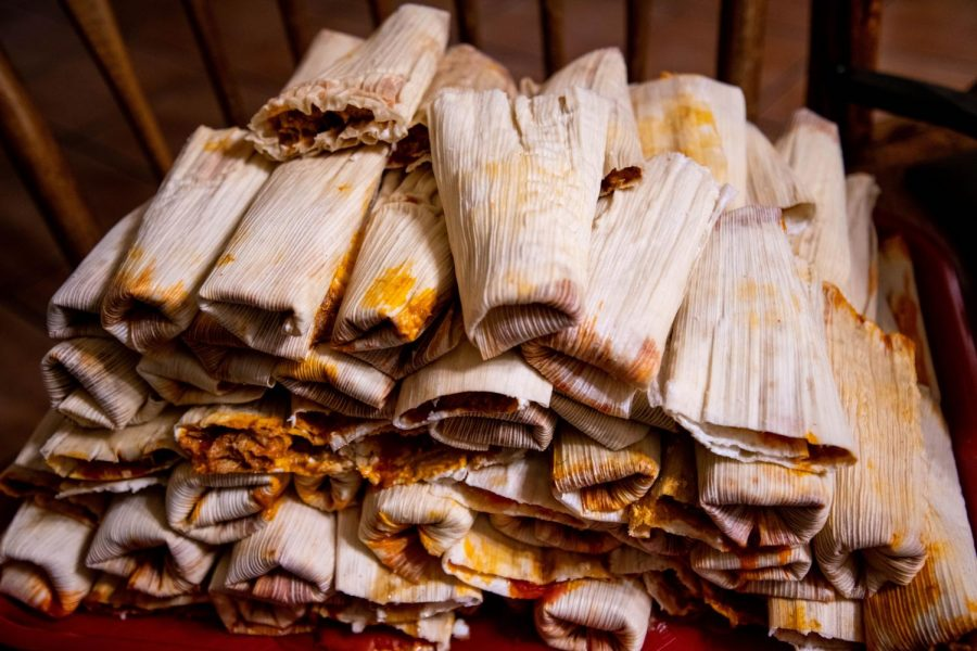 Fresh beef tamales stacked in a pile and ready to be steamed for Christmas dinner.