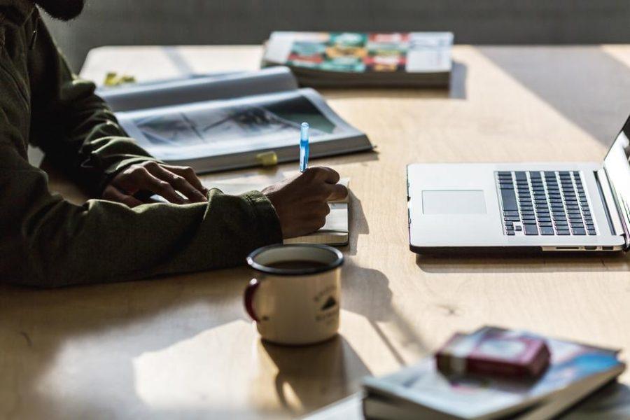 man+writing+at+desk