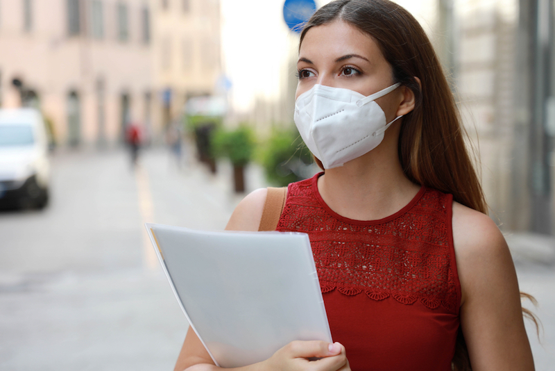 Woman+with+brown+hair+and+red+dress+wearing+mask