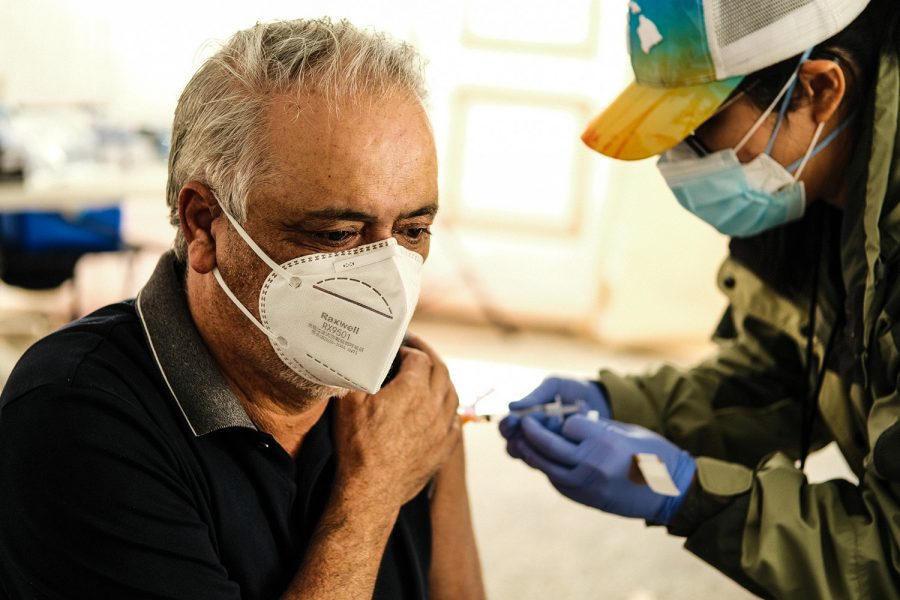Mike Azimi receives his second dose of the Moderna vaccine from Jocelyn Woon at Pierce College's COVID-19 testing and vaccination center n Woodland Hills, Calif., on Feb. 16, 2021.