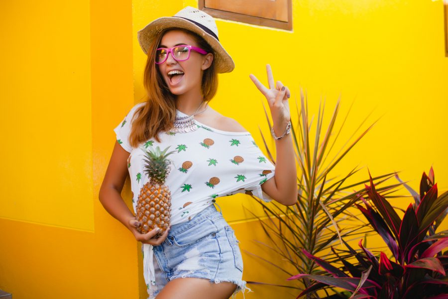 girl+in+pineapple+shirt+holding+pineapple