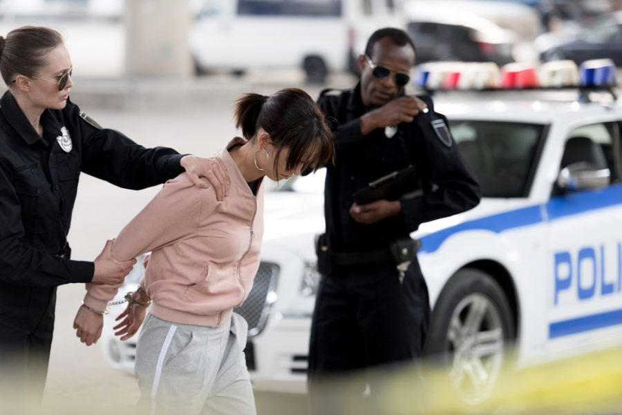 woman being arrested by police