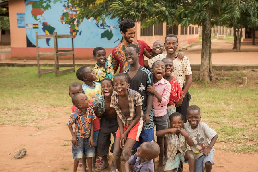 Ghanian children laughing with Peace Corps volunteer