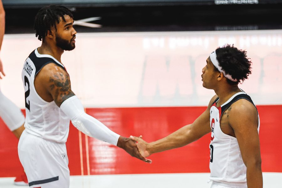 TJ Starks, left, high fives Darius Brown II, right, on court during CSUN's game against University of Hawai'i on Friday, Feb. 20, 2021. CSUN avenged their loss with a 88-80 win the next day.