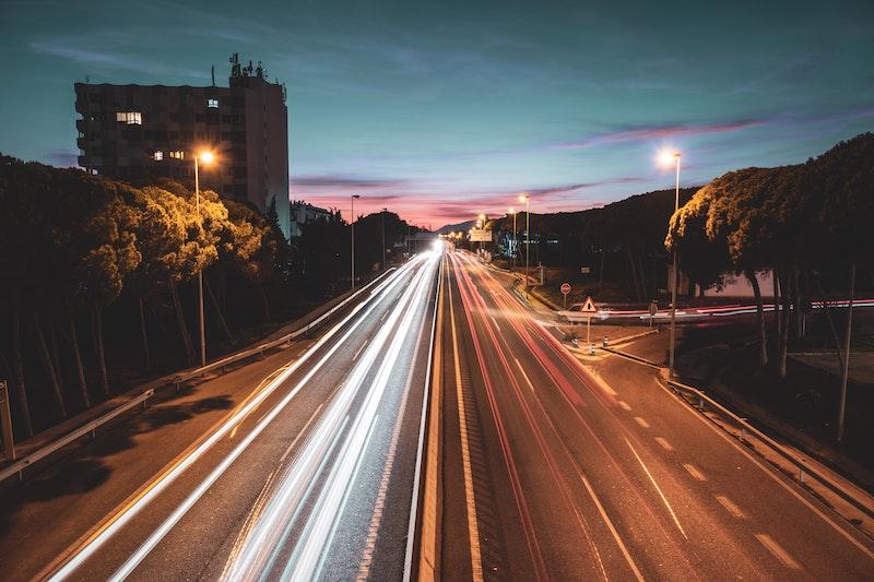 cars speeding at sunset