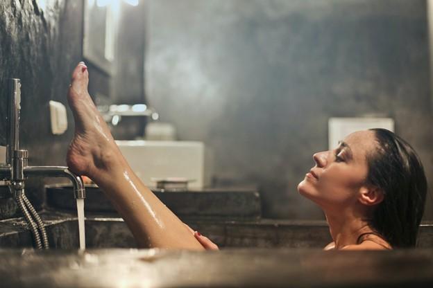 woman bathing in steamy tub