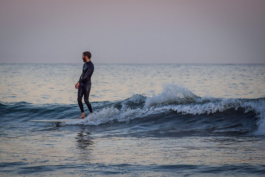 A+surfer+stands+on+his+board+on+Surfrider+Beach+on+Tuesday%2C+Feb.+16%2C+2021.