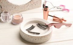 Magnetic eyelashes and accessories on white wooden table