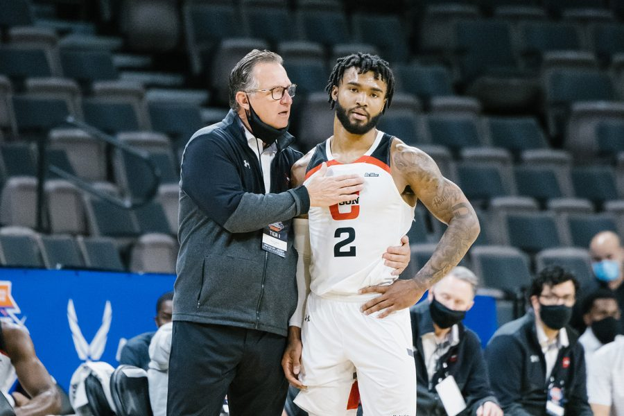 CSUN men's basketball head coach Mark Gottfried, left, and TJ Starks, right, have a pep talk during their game against Long Beach State during the Big West Championships in Las Vegas, Nev., on Tuesday, March 9, 2021. The Matadors lost 85-63.