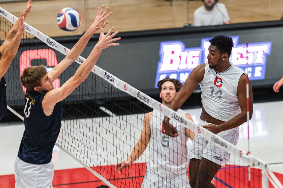 Cole Chea, 14, attempts a spike over the outstretched arms of UC Irvine's Scott Stadick, 13, in the third set of their match at the Matadome in Northridge, Calif., on Sunday, March 21, 2021. The Matadors beat the Anteaters in four sets.