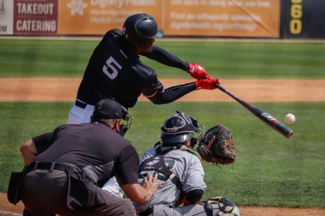 Center fielder Denzel Clarke hits an opposite field homer in the second inning to give the Matadors a 4-2 lead in a game against Cal Poly at Matador Field in Northridge, Calif., on Saturday, March 20, 2021. The Matadors picked up a 13-10 win in their first competitive game in 377 days.