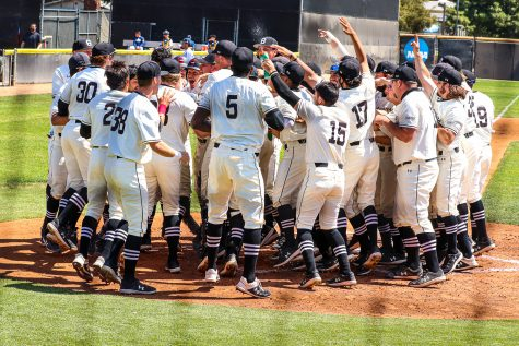 The team celebrates after Ryan Ball hits a walk-off home run to seal their win against UC Irvine at Matador Field in Northridge, Calif. on Saturday, April 3, 2021.