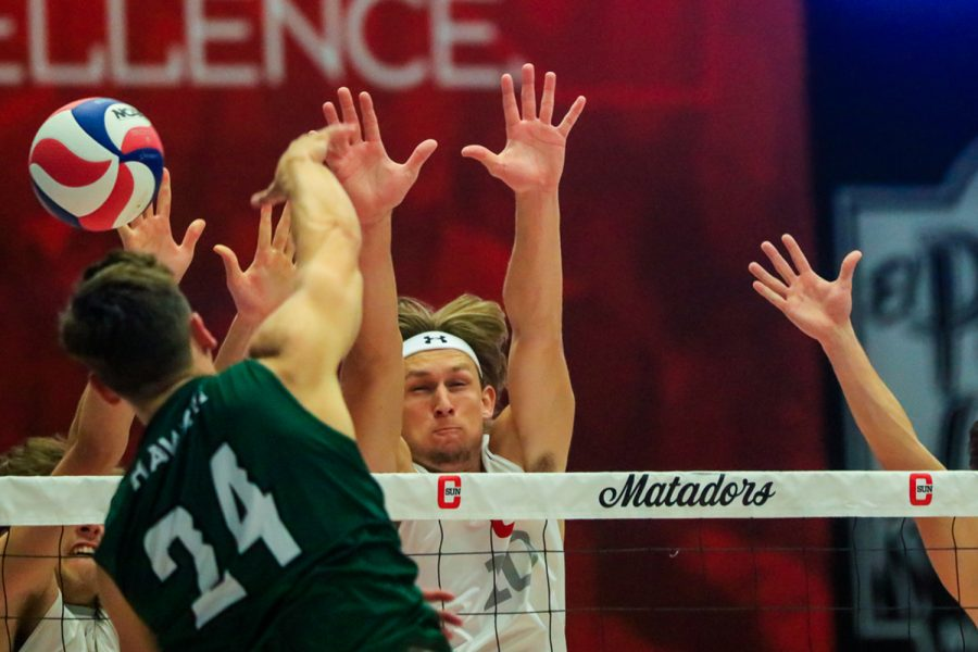 Griffen Walters, Daniel Wetter and Ryan Deweese attempt to block Colton Cowells attack during a match against the Hawaii Rainbow Warriors on Friday, April 9, 2021. The Matadors lost to the Rainbow Warriors, 3-1.