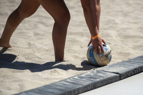 Kailey Klein picks up the ball during CSUNs match against Grand Canyon University at the CSUN Beach Volleyball Complex in Northridge, Calif. on Saturday, April 9, 2021.