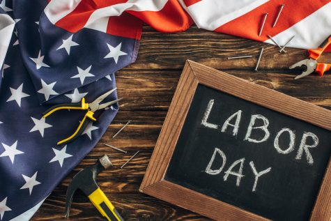 """American flag and chalkboard with the words """"Labor Day"""""""