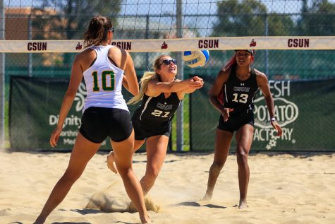Sara Ostojic, left, and Seyvion Waggoner, right, watch as Lexi McLeod, center, keeps the ball in play during a tri-dual against the Concordia-Irvine Eagles and the St. Katherine Firebirds on Saturday, April 3, 2021. The Matadors won 3-2 against the Eagles and 5-0 against the Firebirds.
