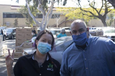 Laura Rathbone and Manny Flores from North Valley Cares Services at the United Methodist Church in North Hills, Calif. on Friday, April 2, 2021.