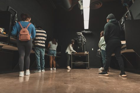 The lab class lines up at their designated stations in the darkroom during the film photography lab class at the Art and Design Center at CSUN in Northridge, Calif. on Tuesday, Mar. 30, 2021.