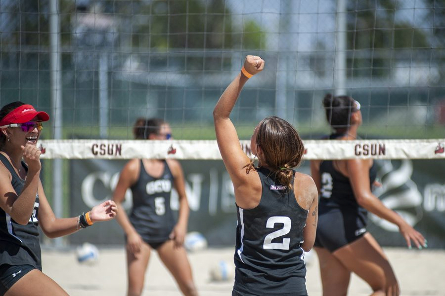 True Mccullough and Emily Sparks celebrate during their match against Grand Canyon University at the CSUN Beach Volleyball Complex in Northridge, Calif. on Friday, April 9, 2021.