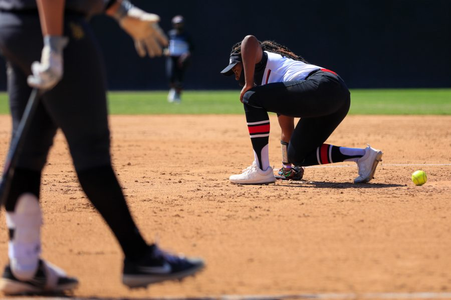 Kenedee Jamerson kneels after getting hit in the stomach during a game against Cal State Long Beach in Northridge, Calif., on Friday, April 2, 2021. The Matadors lost 9-0 in five innings.