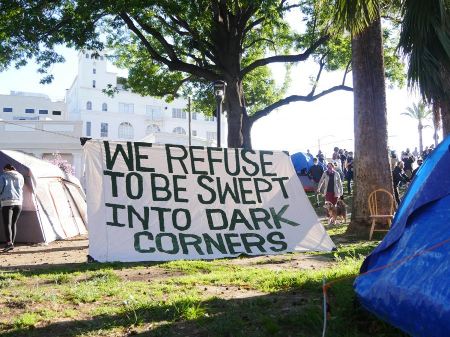 A sign hanging in the encampment at Echo Park Lake in Los Angeles, Calif. on Wednesday, March 24, 2021.
